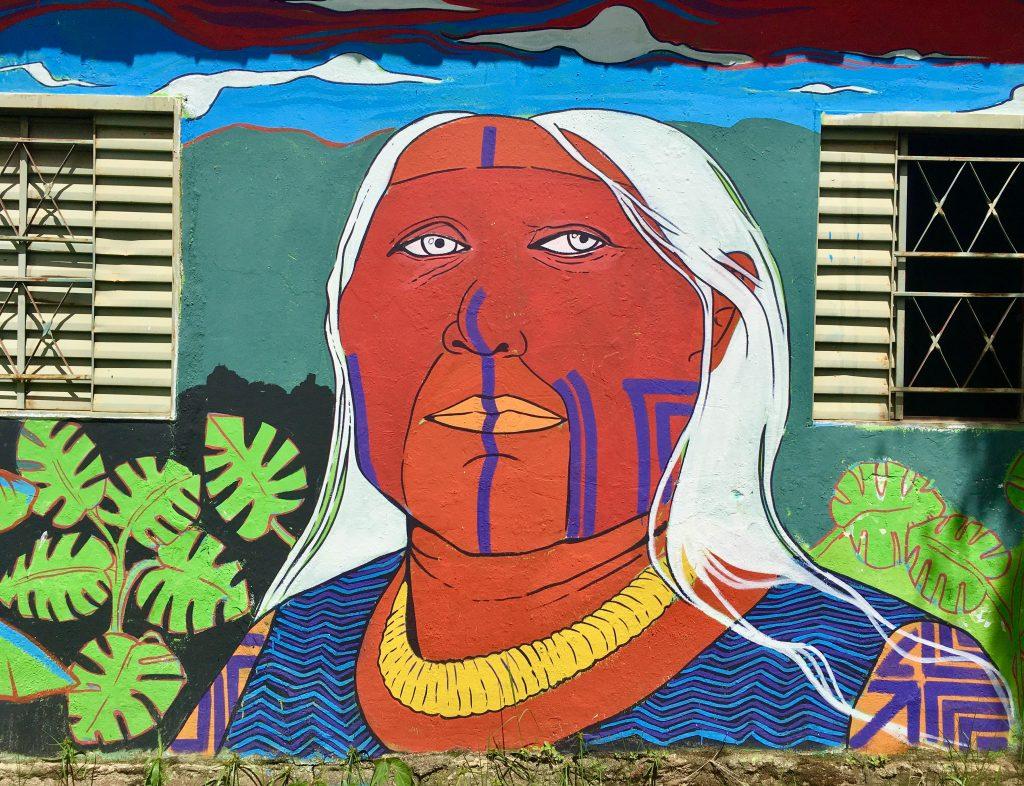 Mural dengan wajah masyarakat adat